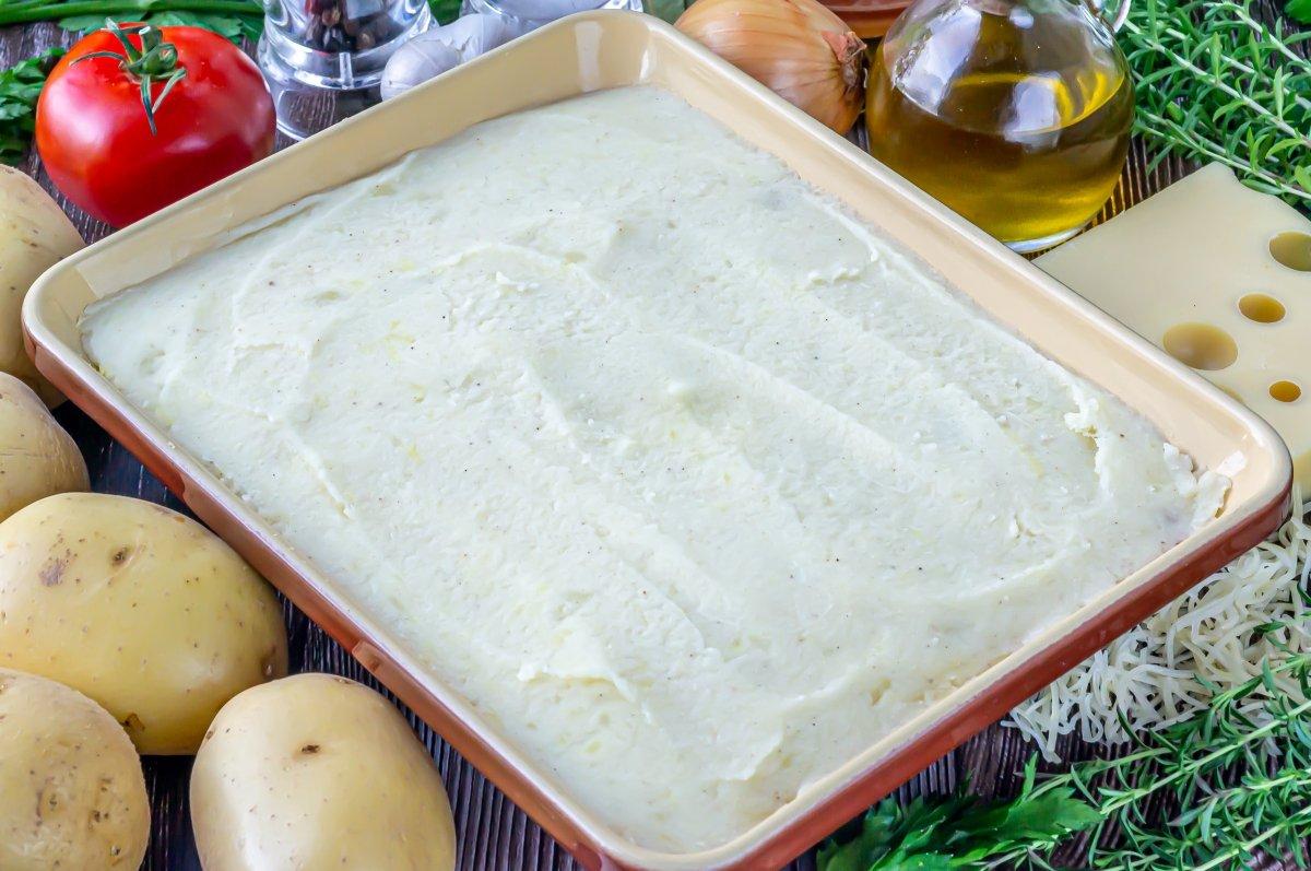 Extender por encima el puré de patatas