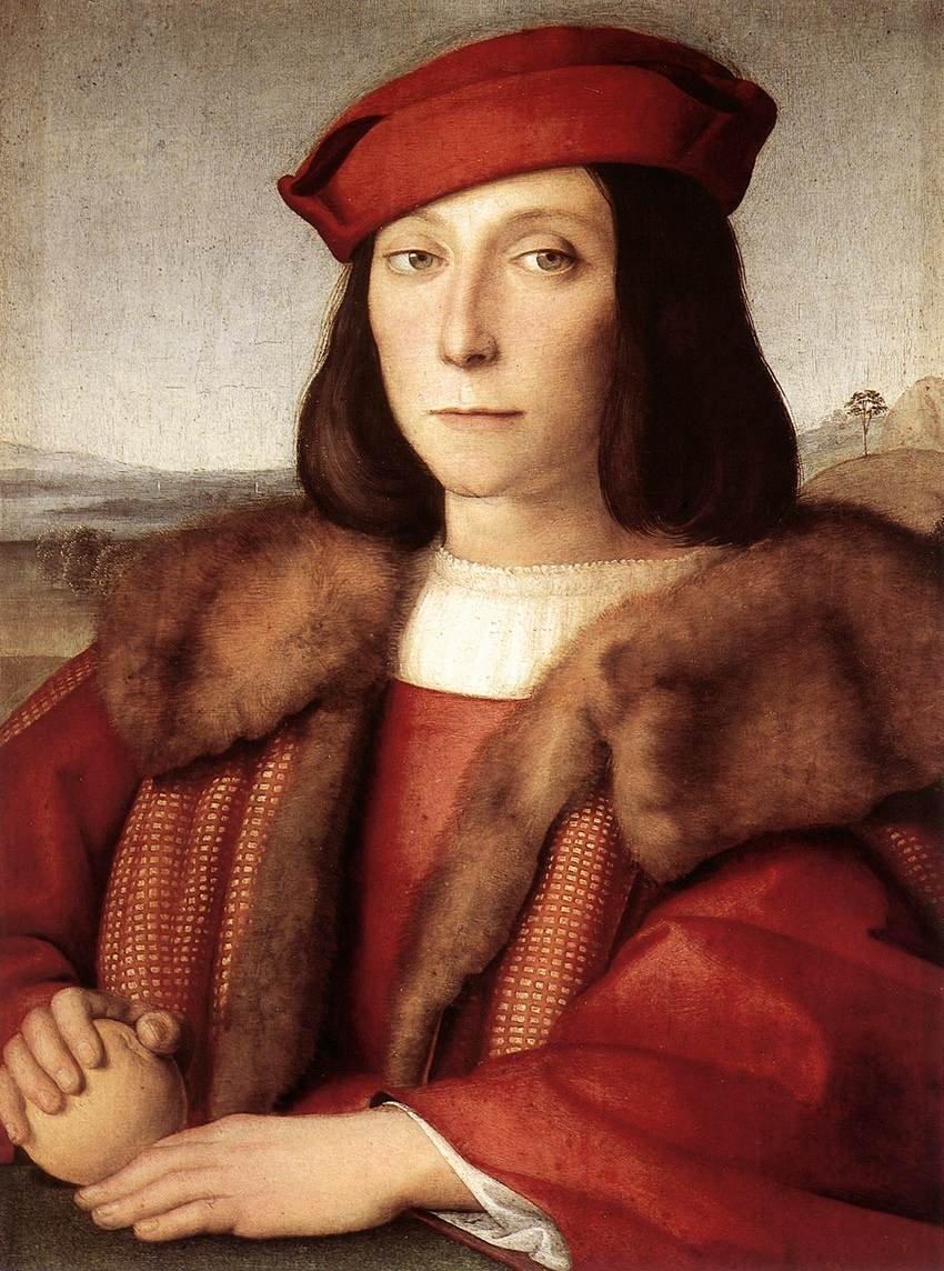 Un joven hombre renacentista con una fruta en las manos